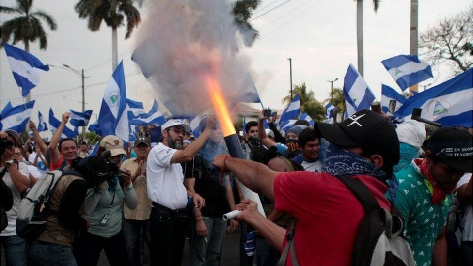 A demonstrator fires a homemade mortar during protest march against Nicaraguan President Daniel Ortega's government in Managua, Nicaragua May 9, 2018.