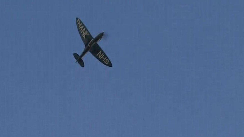 A World War Two Spitfire plane flies over hospitals in Cambridge