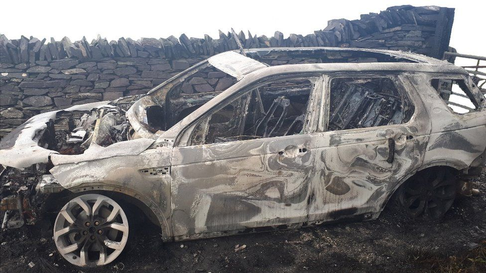 A burned-out Land Rover Discovery