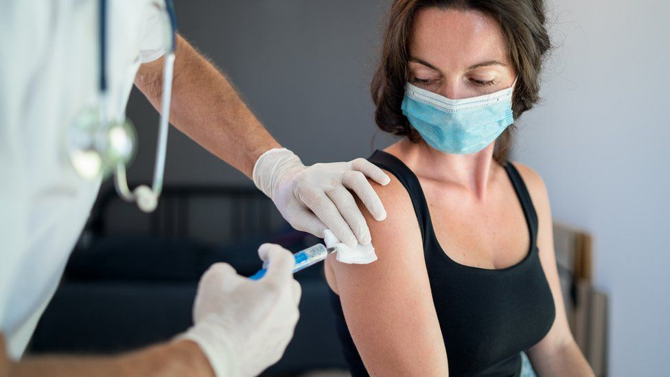 woman getting her vaccine