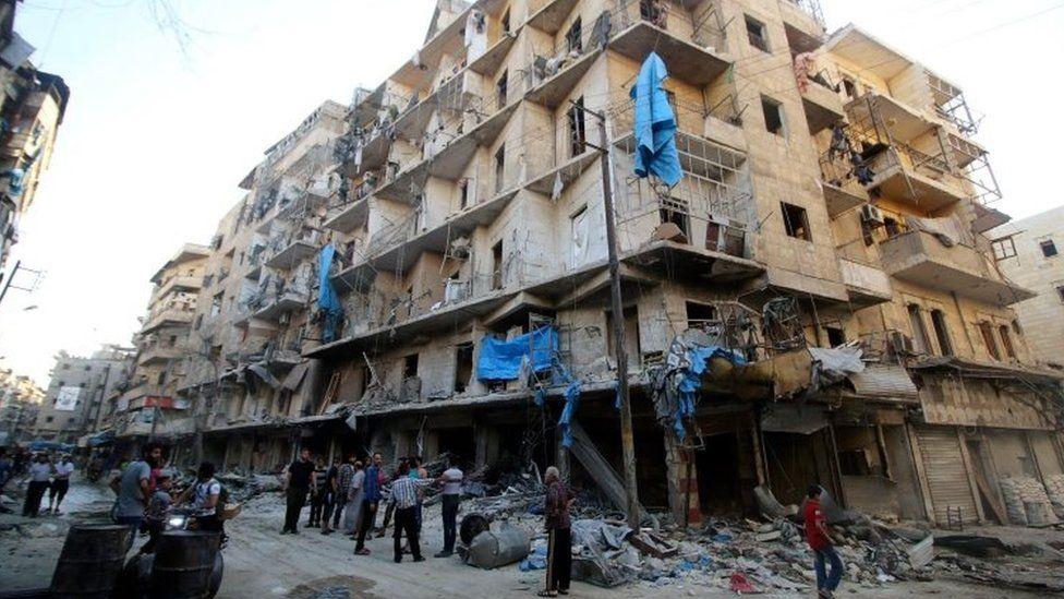 Damage after an air strike on Aleppo's rebel-held al-Shaar neighbourhood (08 June 2016)