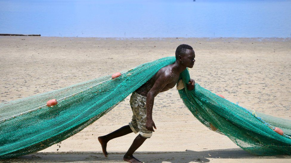 A fisherman pulls a net on the main beach on March 8, 2018 in Mocimboa da Praia, Mozambique.