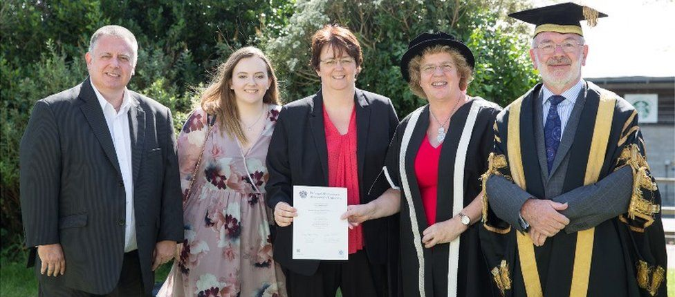 Emily Price's father John, sister Katie and mother Natasha with vice-chancellor Prof Elizabeth Treasure and pro chancellor Glyn Rowlands