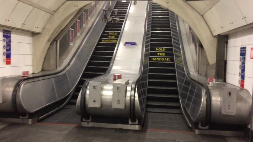 Empty escalators for the Central Line in Oxford Circus