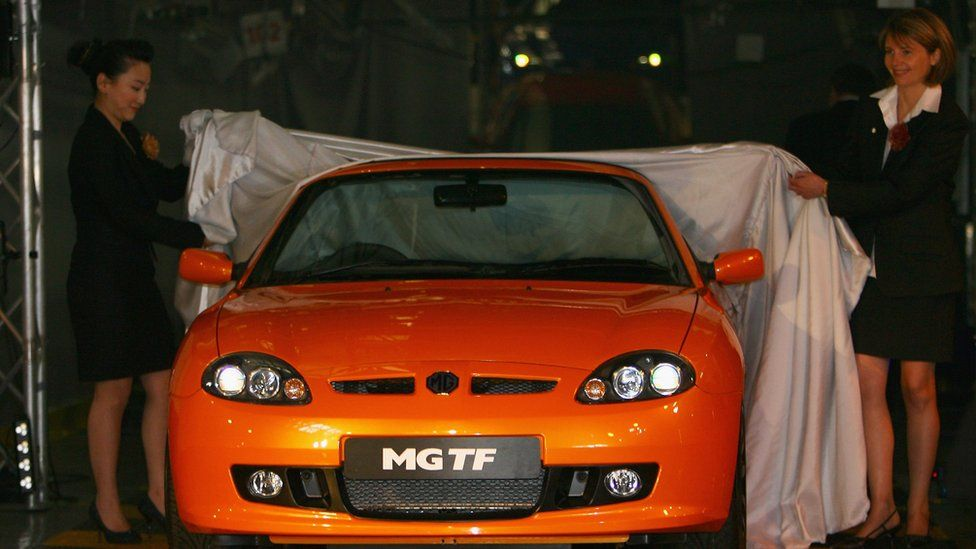 A new MG TF sports car (one of 3 new Sports models by MG) is unveiled on the production line at the NAC (formerly MG Rover) Longbridge factory on May 29, 2007 in Birmingham, England.