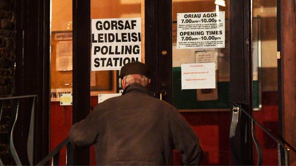 man entering polling station