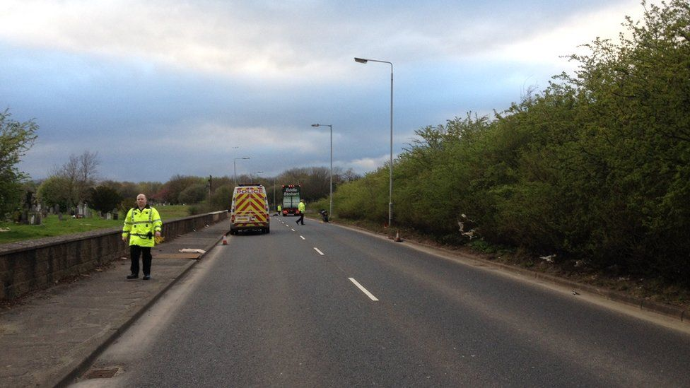 Police on the scene of the accident at Balmore Road