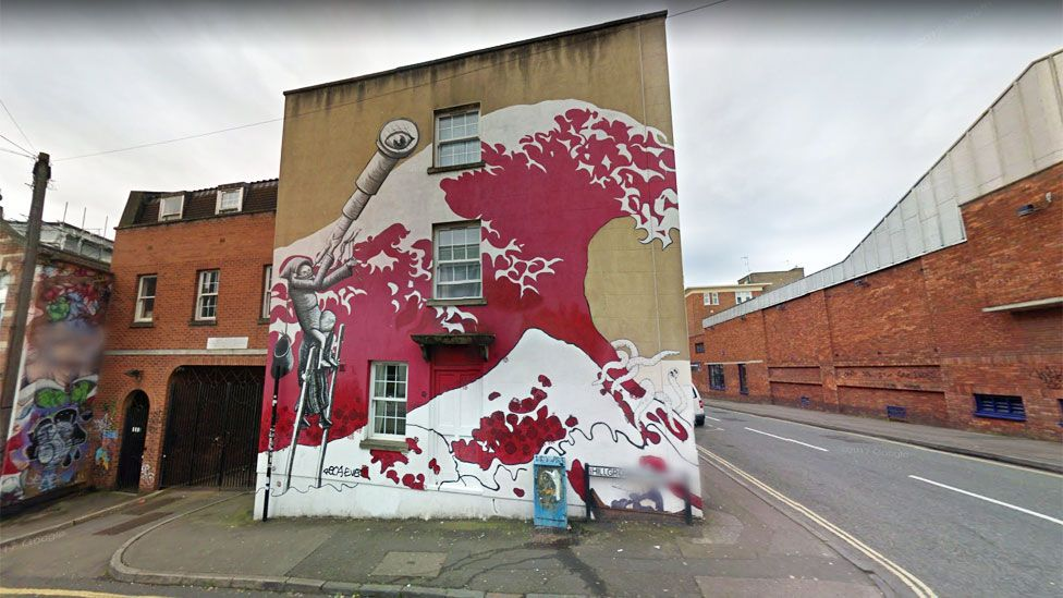 Red wave with aliens, in Bristol