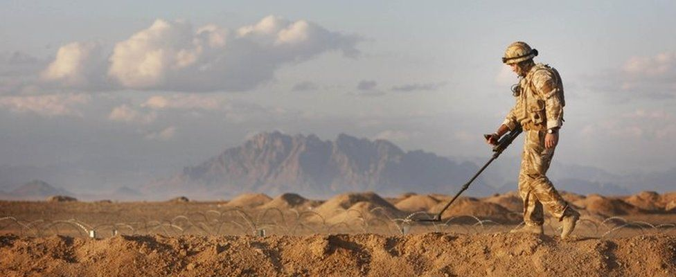 A British soldier sweeps for IEDs in Afghanistan
