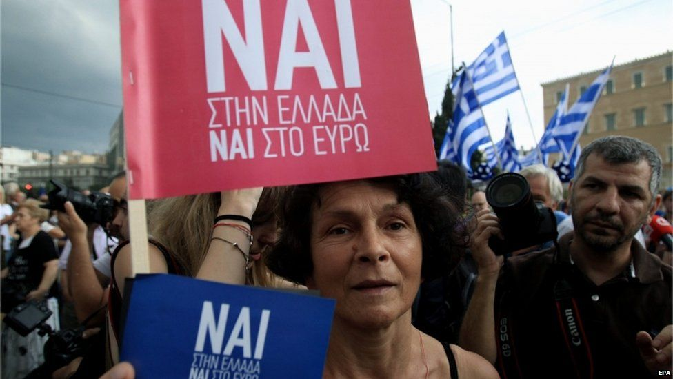 "Protesters supporting a ""Yes"" to the referendum and demanding Greece to remain in the Eurozone rally outside the Greek Parliament in Athens, Greece, 30 June 2015."