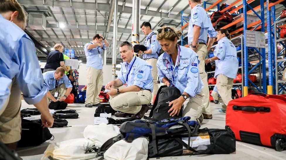 The Australian medical team packing their bags in a hangar prior to departure to Christmas Island
