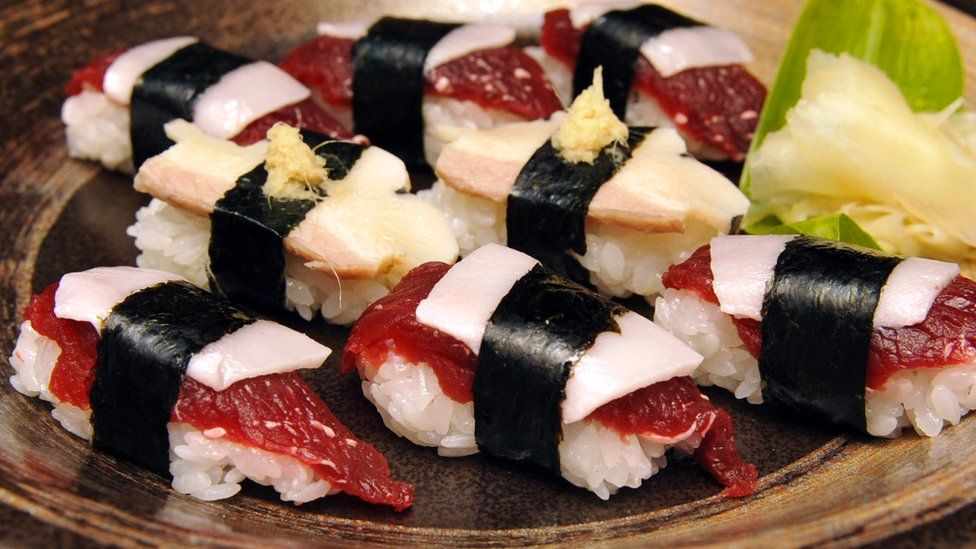 pieces of whale sushi made from sliced minke meats, blubber and rice balls