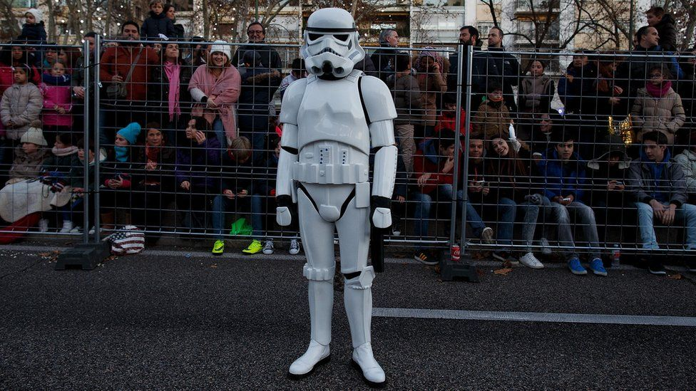 A man dressed as a Stormtrooper waits for the start of the Three Kings parade in Madrid in 2016.