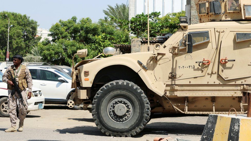 A Saudi soldier walks past an armoured vehicle in Aden, Yemen (6 November 2019)