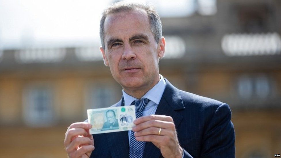 Mark Carney with the UK's new £5 note