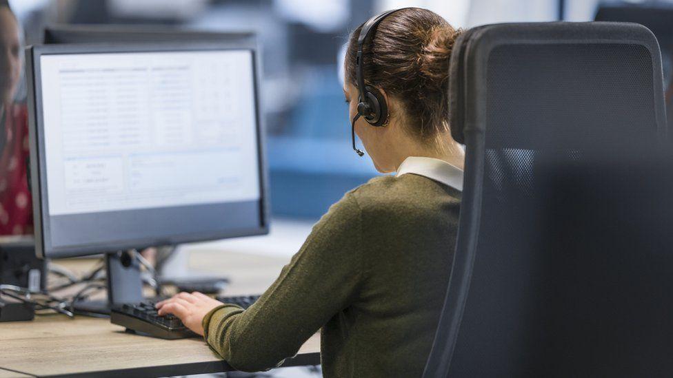Customer service representative working in call centre