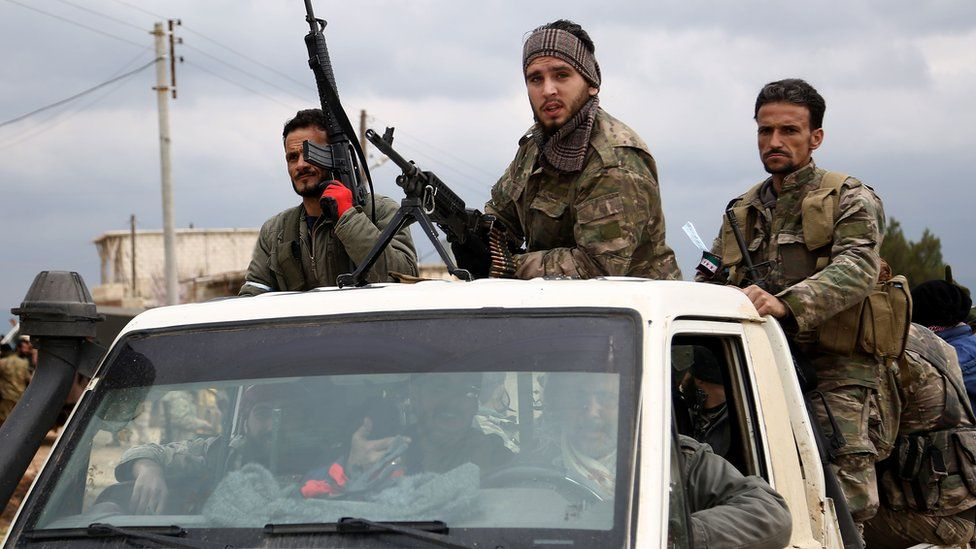 Turkish-backed Syrian rebel fighters stand in a vehicle as they fight Kurdish forces in Afrin (21 February 2018)