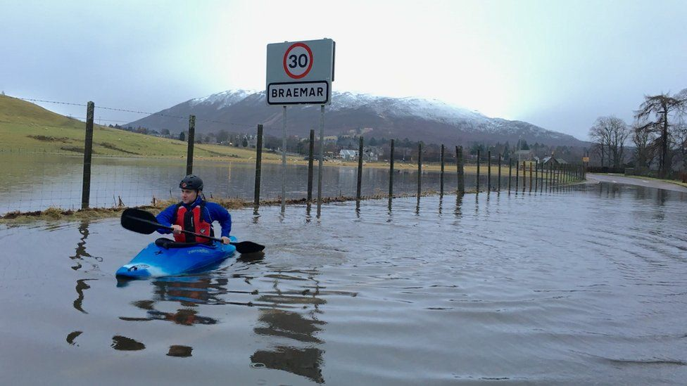 Man kayaking along the A93 at Braemar