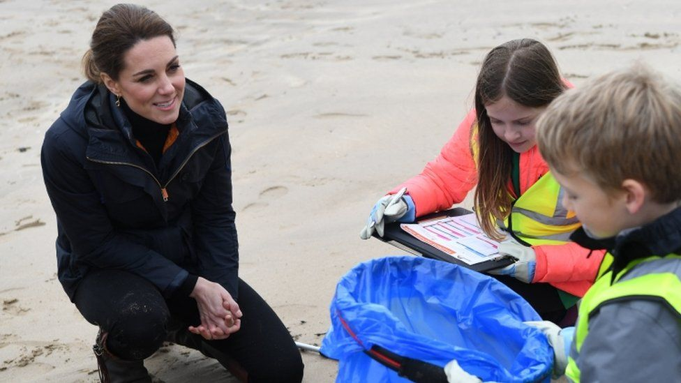 Catherine, Duchess of Cambridge joins primary school pupils in a beach clean-up on Newborough Beach