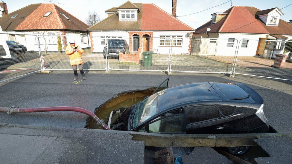 A car in a sinkhole in Brentwood