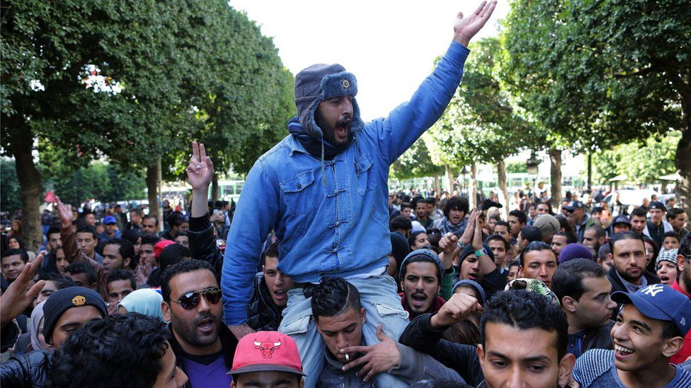 Unemployed graduates shout slogans during a demonstration urging the government to provide them with job opportunities, in Tunis, Tunisia, 21 January 2016