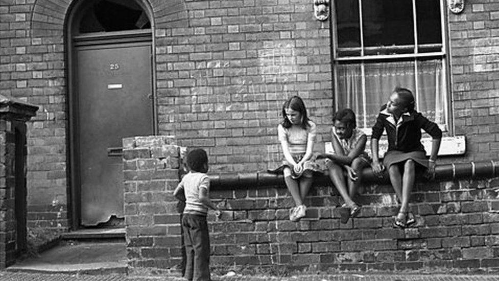 Children sitting on wall in 1991