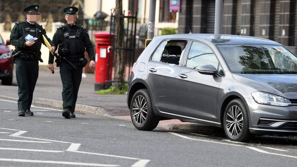 Police officers at the scene of the security alert