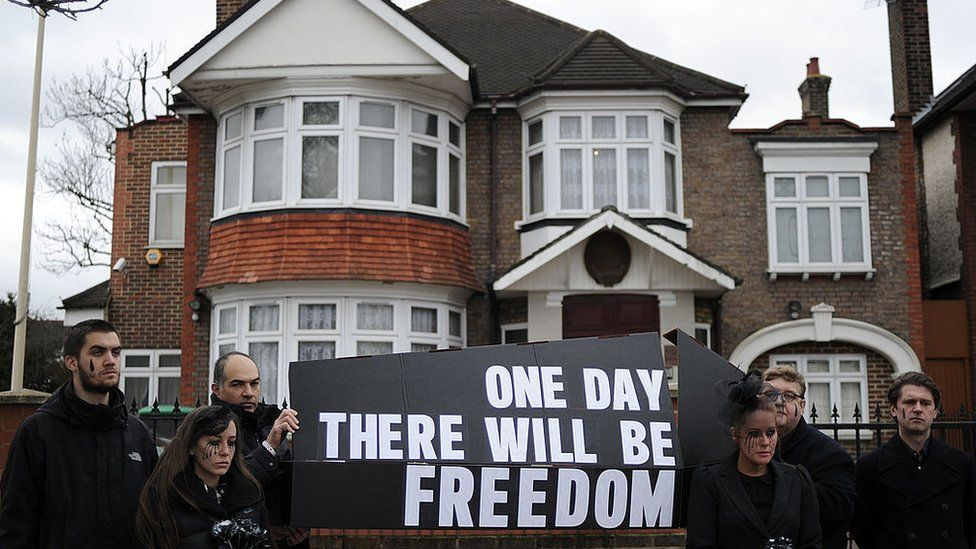 Members of Christian rights group 'Release International' take part in a protest outside the North Korean embassy in west London on January 20, 2012, to demonstrate for personal and religious freedom in North Korea