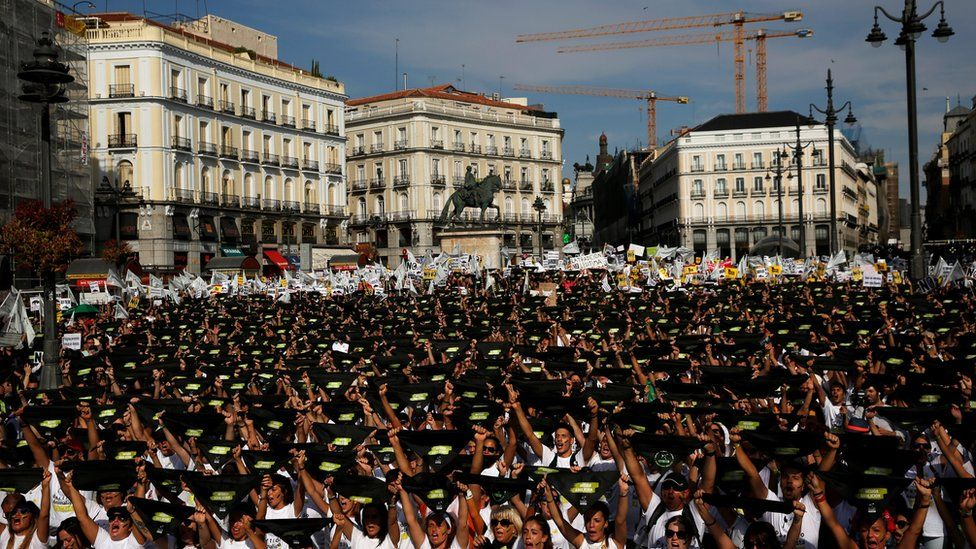 Animal rights activists hold black neckties at the start of a demonstration to demand a ban on bullfighting in Madrid