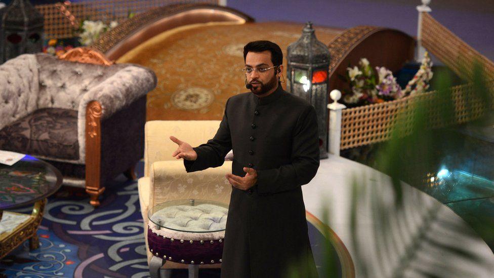 In this photograph taken on 31 July 2013, Pakistani television show host Aamir Liaqat Hussain presents an Islamic quiz show Aman Ramadan in Karachi.