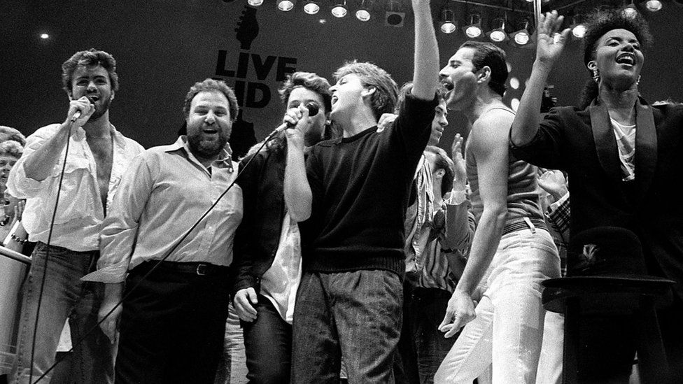 George Michael (far left) with Bono, Paul McCartney and Freddie Mercury during the finale of Live Aid in 1985