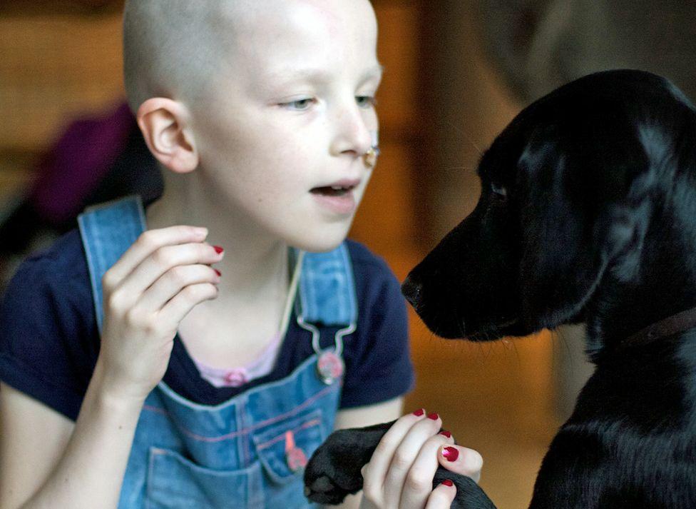 Niamh with a black Labrador