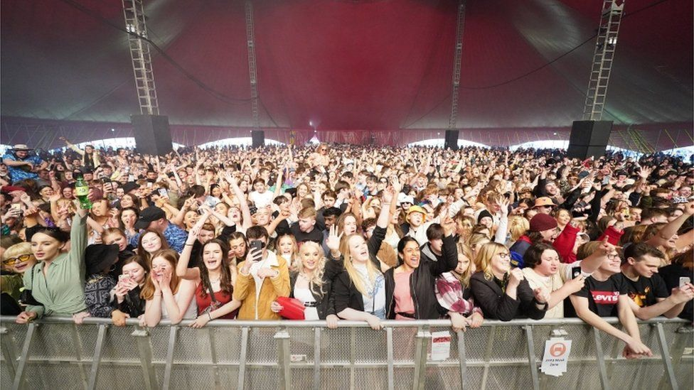 People watch Zuzu perform on stage at a music festival in Sefton Park in Liverpool as part of the national Events Research Programme (ERP)