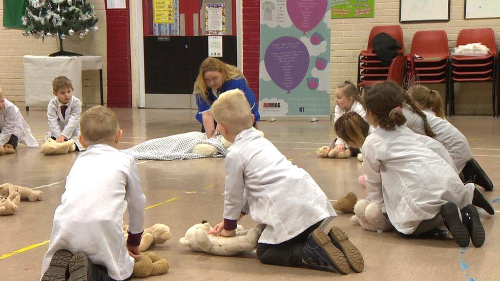 Children learning first aid