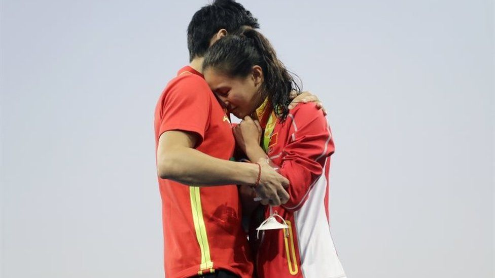 """China""""s diver Qin Kai, left, proposes to silver medalist He Zhi of the women""""s 3-meter springboard diving finals in the Maria Lenk Aquatic Center at the 2016 Summer Olympics in Rio de Janeiro, Brazil, Sunday, Aug. 14, 2016."""