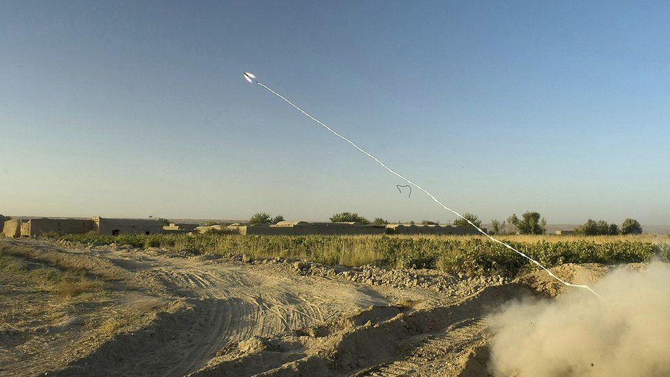 A rocket attached to a string