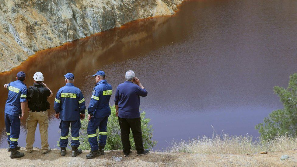 Fire-fighters and investigators are searching the Red Lake in Mitsero using robotic equipment to navigate its toxic water