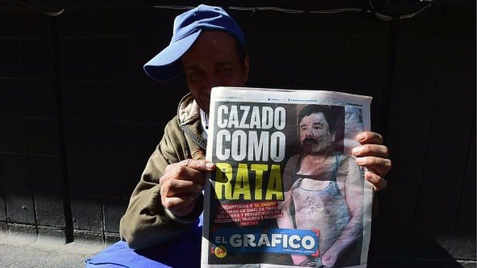 A street vendor shows a newspaper in Mexico City with a picture of drug kingpin Joaquin 'El Chapo' Guzman on its front page