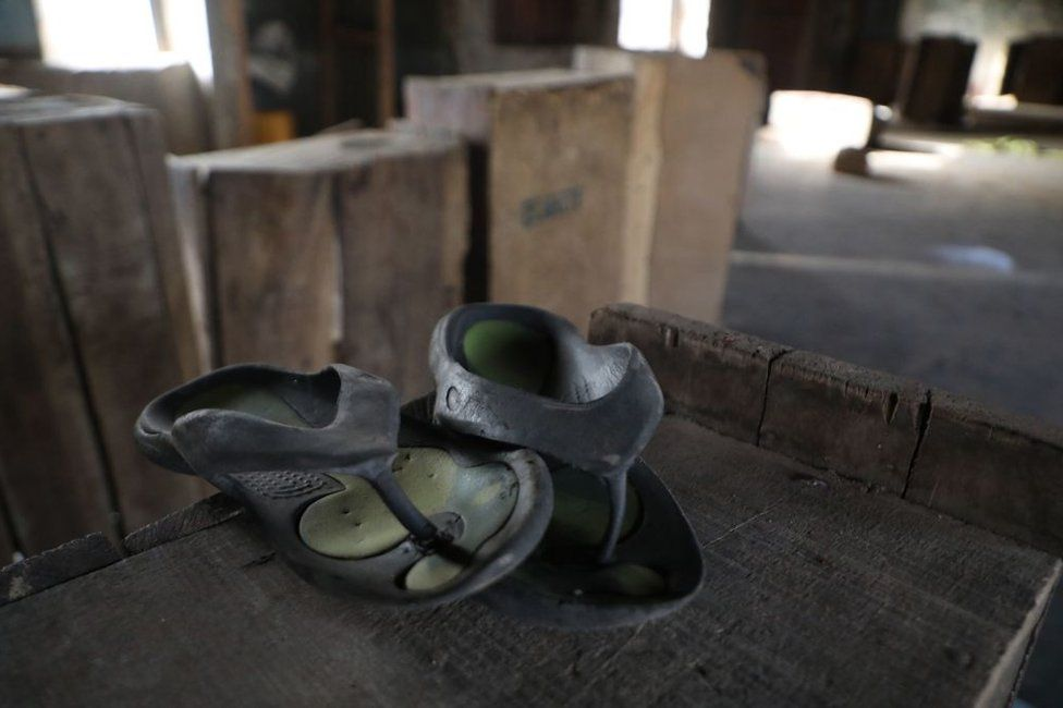 A pair of child-sized rubber sandals stand on a wooden crate in Kagara, Niger State, Nigeria - Thursday 18 February 2021