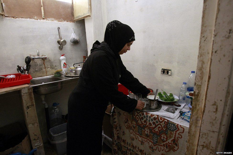 Palestinian refugee from Syria in a makeshift home in Shatila