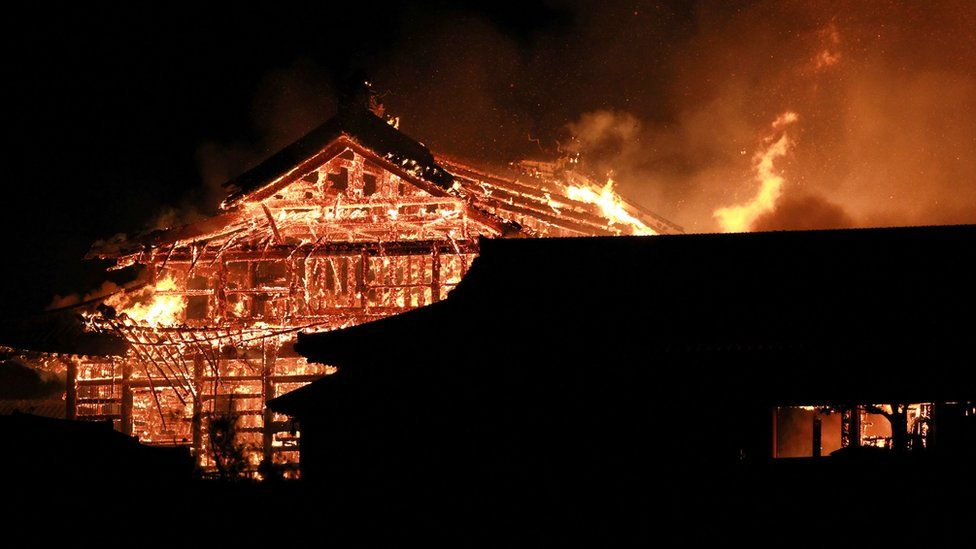 The main building of the Shuri Castle is seen on fire in Naha