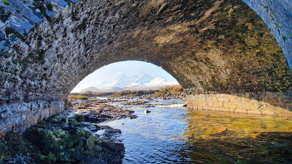 Cuillins seen from under bridge