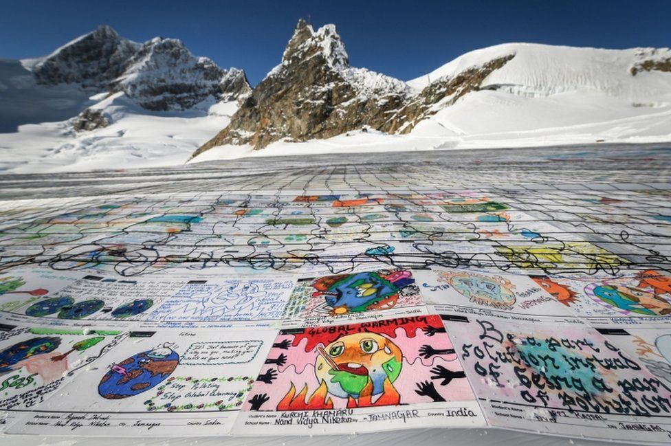An aerial view shows a massive collage of drawings about climate change rolled out on the Aletsch Glacier in the Swiss Alps