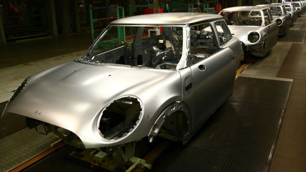 A Mini on the assembly line at the BMW factory in Oxford