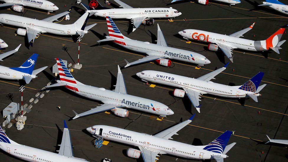 rounded Boeing 737 MAX aircraft are seen parked in an aerial photo at Boeing Field in Seattle on 1 July, 2019.