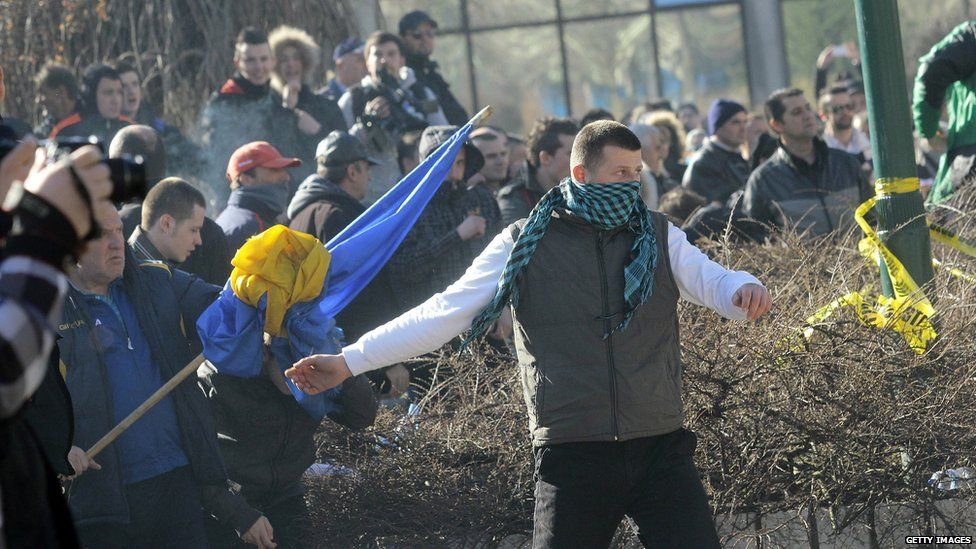 Bosnian protestors try to storm a local government building in the Bosnian capital Sarajevo