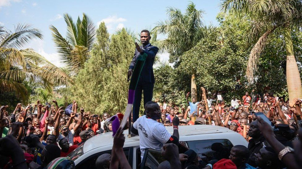 Ugandan pop star turned opposition MP, Robert Kyagulanyi, delivers a speech outside his home in Kampala, Uganda, after returning from the United States on September 20, 2018.