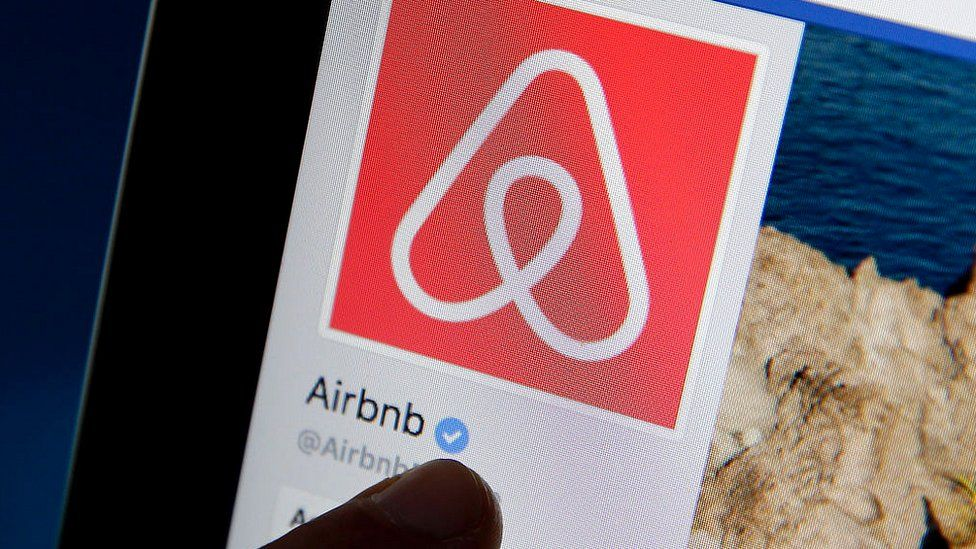 The Airbnb logo on a tablet