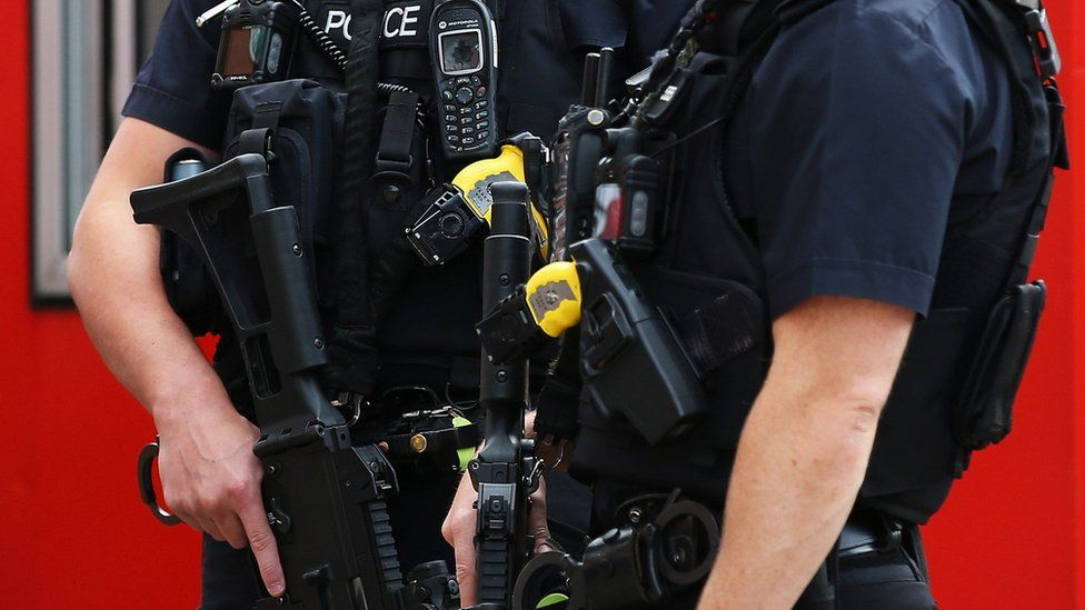 armed police holding guns in Liverpool