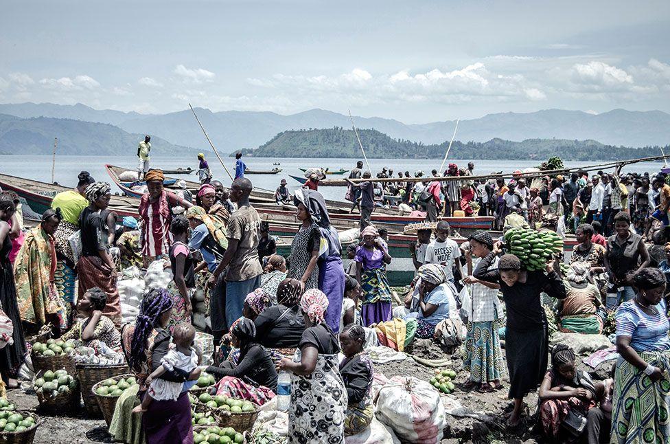 Vendors and shoppers at Kituku market on the shores of Lake Kivu